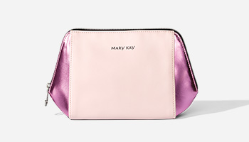 A pink and pink iridescent Mary Kay makeup bag is displayed.